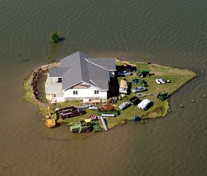 Arial view of house surrounded by flood water